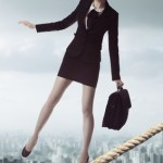business woman in unstable balance