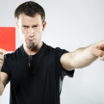 Soccer referee showing a red card and blowing a whistle